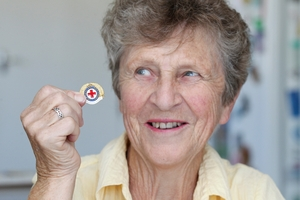 Meg Dawson, of Napier, with the Red Cross Distinguished Services award she received at the weekend. Photo / Duncan Brown