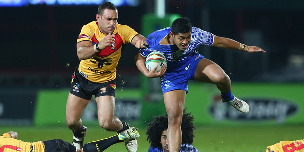 Anthony Milford of Samoa breaks through a number of tackles against Papua New Guinea. Photo / Getty Images