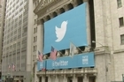 Twitter makes its Wall Street debut Thursday with a price tag of $26 per share, bidding to raise up to $2.1 billion in the most eagerly awaited stock offering since Facebook.