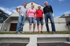 Lindsay and Lynne Mack, Ngaire Blackbourn and Tony Haslett are concerned there is inadequate drainage for their Mount Maunganui homes. Photo / Joel Ford