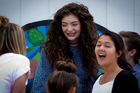 Kiwi superstar Lorde (pictured centre, with contestants) visited Belmont Intermediate School. Photo / Sarah Ivey