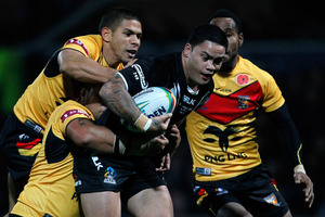 Papua New Guinea defenders wrap up Isaac Luke. Photo / Getty Images