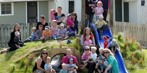 All the happy faces at the opening of the Hunterville Playcentre's new playground yesterday.  PHOTO/STUART MUNRO 151113WCSMPLAYCENTRE1