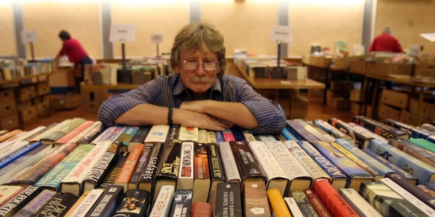 BOOK BOUND: Steve Trotman, Wairarapa Heart Foundation volunteer, surveys some of the thousands of donated titles for sale at the 17th annual fundraiser book sale in the Masterton Town Hall this weekend. PHOTO/LYNDA FERINGA
