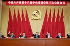 Chinese President Xi Jinping (centre) and other Communist Party leaders are promising a bigger role for market forces.Picture / AP
