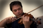 Dimitri Atanassov soared in his last appearance as the APO's concertmaster. Photo / APN