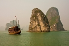 A cruise on Halong Bay is a tranquil escape from Vietnam's humming cities. Karst islands like these are commonly depicted in Vietnamese and Chinese art.