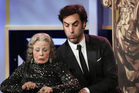Sacha Baron Cohen pretends to fall on a presenter during the 2013 Bafta Los Angeles Britannia Awards Photo / AP
