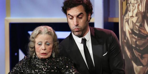 Sacha Baron Cohen pretends to fall on a presenter during the 2013 Bafta Los Angeles Britannia Awards Photo / AP