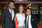 Actors Liam Hemsworth, left, Jennifer Lawrence and Josh Hutcherson pose for photographers at the World Premiere of 'The Hunger Games: Catching Fire'. Photo / AP