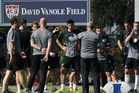 Members of the New Zealand national soccer team look on during a break in their training session at StubHub Center. Photo / Getty Images.