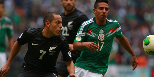 Jesus Escoboza of Mexico struggles for the ball with Leo Bertos of New Zealand during a match between Mexico and New Zealand. Photo / Getty Images.