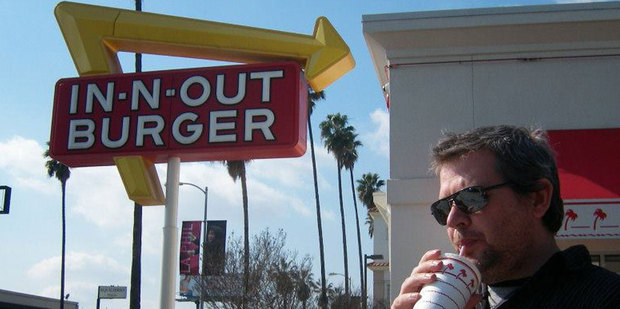 A man enjoying In-N-Out Burger's wares in Los Angeles. Photo / Janie Smith