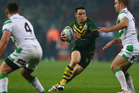 Cooper Cronk (C) of Australiacuts between Liam Finn (R) and Joshua Toole (L) of Ireland during the Rugby League World Cup. Photo / Getty Images.