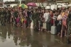 Desperately needed food, water and medical aid are only trickling into areas hardest hit from Typhoon Haiyan, while thousands of victims jammed the damaged airport, seeking to be evacuated. Damaged infrastructure is hampering relief efforts.