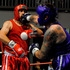 "In red Simon ""The Cyclone'' Sekona vs Chris Harper ""The Next Perker'' in blue. Photo / George Novak"