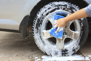 Cleaning the wheel with a sponge