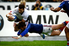 Cory Jane is bundled into touch by Maxime Medard at Stade de France yesterday. Photo / Getty Images