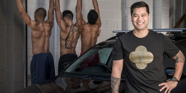 Neil Ieremia with his Audi and some of the Black Grace Dancers. Photo by Ted Baghurst.