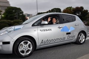 Japanese Prime Minister Shinzo Abe tries out a self-driving vehicle.