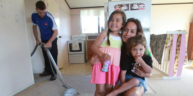 Nadia Dickson and her children Eiva, 5, and Nakitta, 2, in their home after a water cylinder burst at 2am.  Photo / John Borren