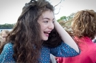 Teen singing sensation Lorde has surprised students from her old school with a visit to judge its annual talent quest.