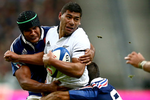 Charles Piutau is tackled by Thierry Dusautoir of France. Photo / Getty Images