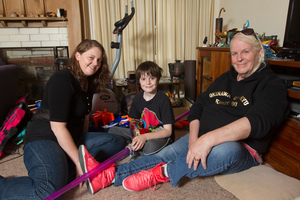 Lexie, right, and Cushla Matheson with their martial arts-mad son Finn, aged 11, at their Auckland home. Photo / Mark Mitchell
