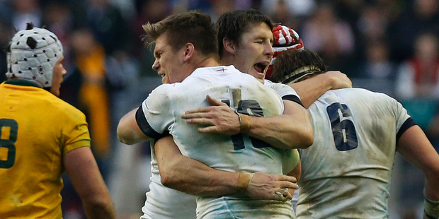 England's Joel Tomkins, center right, and Owen Farrell, center left, celebrate their win against Australia at the end of their autumn international rugby match at Twickenham Stadium in London. Photo / AP