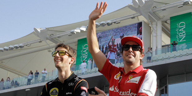 Ferrari driver Fernando Alonso (right) will be racing at the Austin, Texas Formula One round despite a back injury. Photo / AP