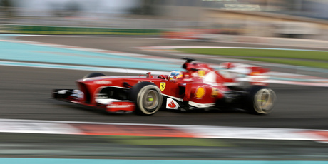 Ferrari driver Fernando Alonso steers his car during the Emirates Formula One Grand Prix at the Yas Marina racetrack in Abu Dhabi, United Arab Emirates. Photo / AP