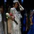 Miss Universe 2013 Gabriela Isler from Venezuela adjusts her crown.Photo / AFP