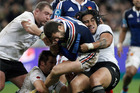 France's Brice Dulin is tackled by New Zealand's All Blacks players during their international rugby match at the Stade de France stadium in Saint Denis. Photo / AP