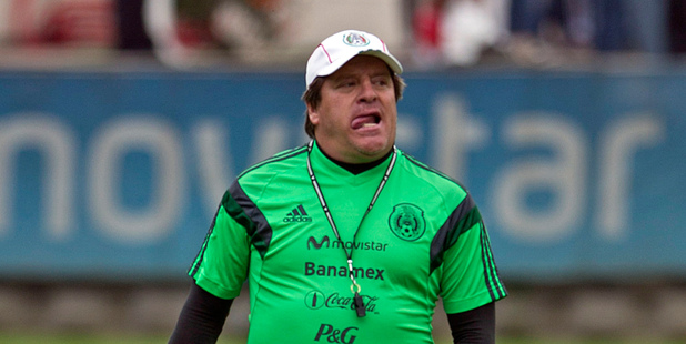 Mexico's soccer coach Miguel Herrera walks to a press conference after a friendly match with Lobos in Mexico