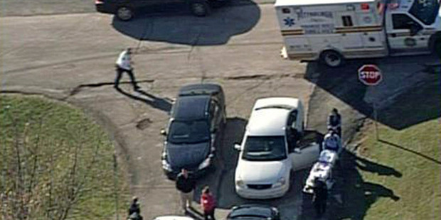In this aerial image provided by KDKA-TV, emergency personal head to the scene near Brashear High School in Pittsburgh. Three students were shot.