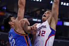 Steven Adams defends against against Blake Griffin during Oklahoma City's game against Los Angeles today. Photo / AP