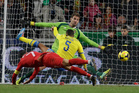 Portugal's Cristiano Ronaldo, left, scores the opening goal past Sweden goalkeeper Andreas Isaksson, background right, during the World Cup qualifying playoff first leg. Photo / AP