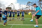 All Whites and Blackburn Rovers player Tim Payne (right) works with Sacred Heart's Alistair Tremlett (left) and his fellow students. Photo / APN