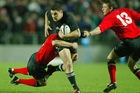 Dan Carter has fond memories of his debut against Wales in 2003 (left) but is refusing to get carried away with the hype of his 100th test. Photo / Getty Images