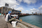 A man fishes at Wynyard Quarter on Auckland's waterfront. Photo / Doug Sherring