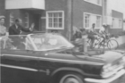 Queen Elizabeth II and Prince Phillip driving along Cameron Road during their visit, 1963.