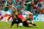 All Whites captain Tommy Smith, seen fighting for possession with Mexico's Oribe Peralta, has backed coach Ricki Herbert. Photo / AP