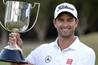 Adam Scott up the Kirkwood Cup as he celebrates victory during day four of the PGA Royal Pines. Photo / Getty Images