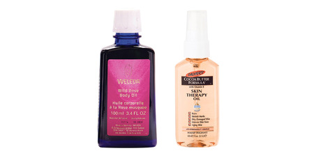 Weleda Wild Rose Body Oil; Palmers Skin Therapy Oil. Photo / Supplied.