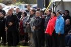 Whanganui people back Turama Hawira's speech with a song. PHOTO/STUART MUNRO 121113WCSMTRIBUNAL3