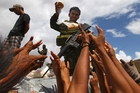 A Filipino soldier hands out bread to survivors in Maraboth. Photo / AP