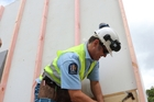 NAILED IT: Jim Adamson, police constable, hammers away at the Habitat for Humanity Big Town Metra Build. PHOTO/ JOHN STONE