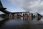 Flights arrive at Tacloban crammed with aid and then leave with people lucky enough to get a place on the plane. Photo / AP