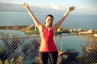 Sophie Barr celebrates after competing a run to the Bluff Hill Lookout as part of the training for  her 4 in 1 Challenge.