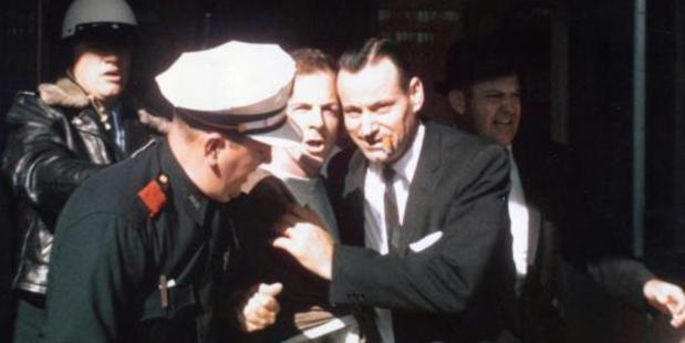 Lee Harvey Oswald is arrested at the Texas Theatre in Dallas, Texas.